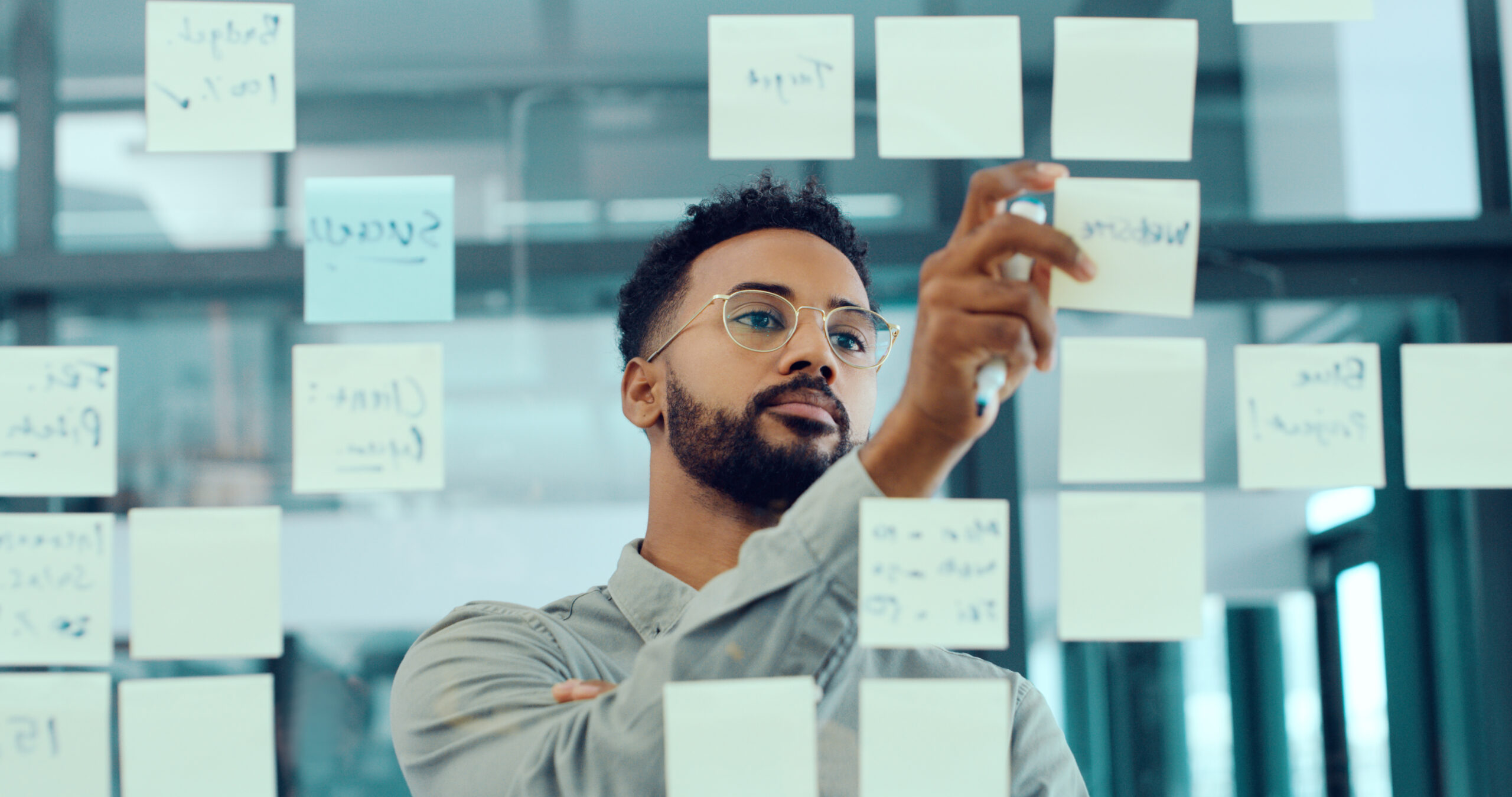 Shot of a young businessman having a brainstorming session in a modern office